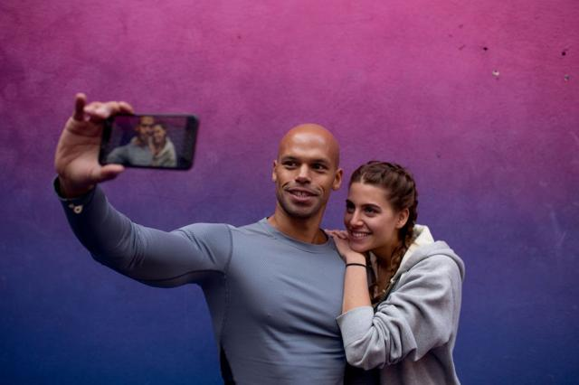 couple taking a selfie after the gym