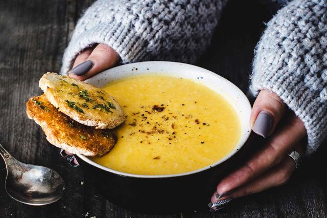 girl holding bowl of soup