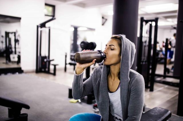 girl training and working out drinking water