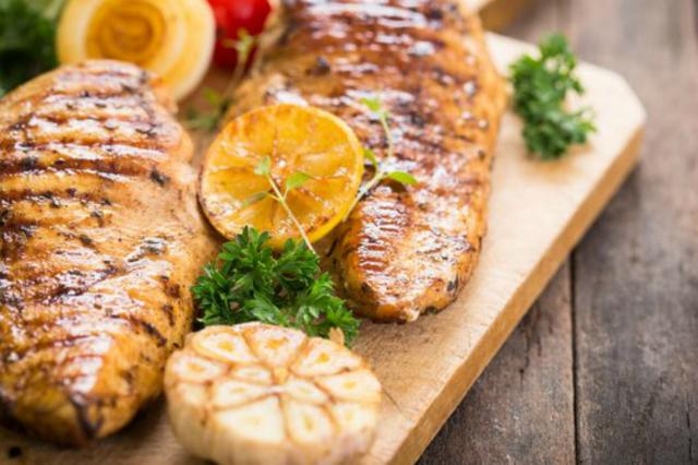 Grilled Chicken Breast on Cutting Board