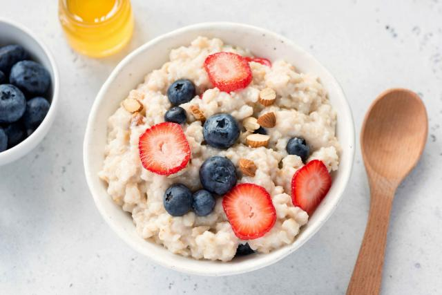 Oatmeal porridge with fresh berries in a bowl