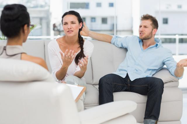 Angry couple talking to their therapist
