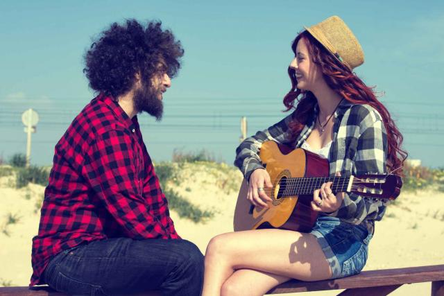 Young couple playing a guitar