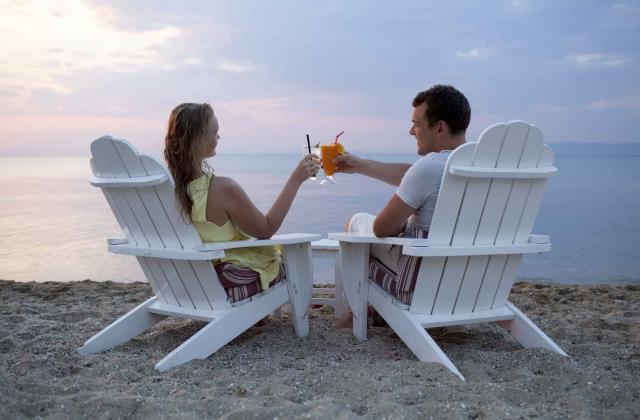 Romantic couple toasting the sunset