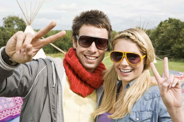 Portrait of happy couple in sunglasses
