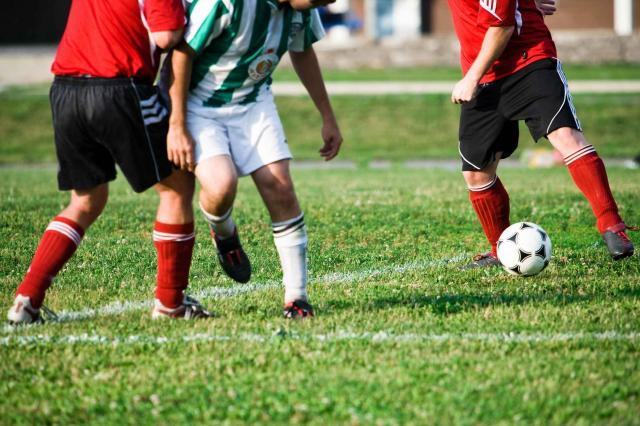 Players competing in soccer match