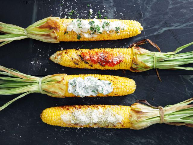 Grilled corn with toppings