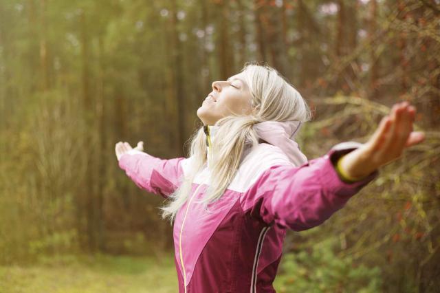 Woman breathes fresh air outdoors