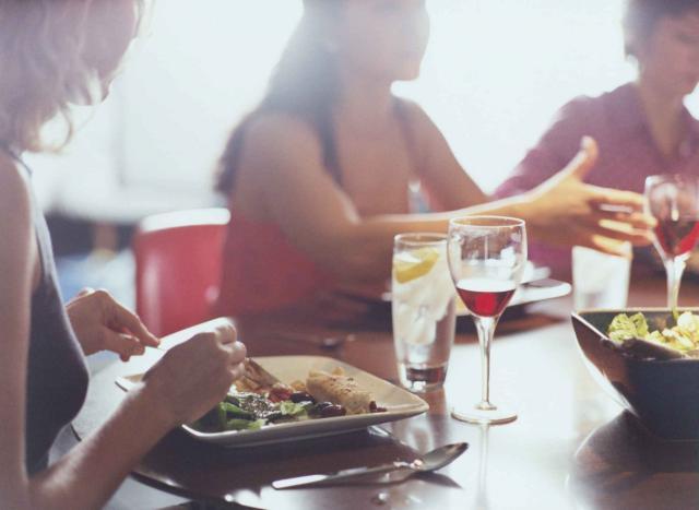 Three Women Talking over Dinner