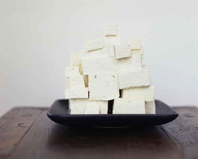 Tofu cubes stacked on platter