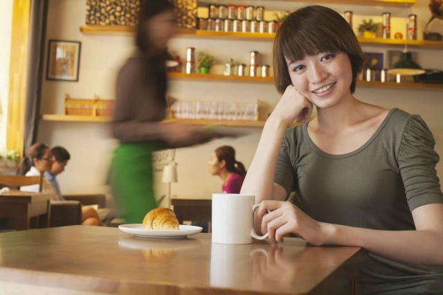 Portrait of young woman at a coffee shop, Beijing