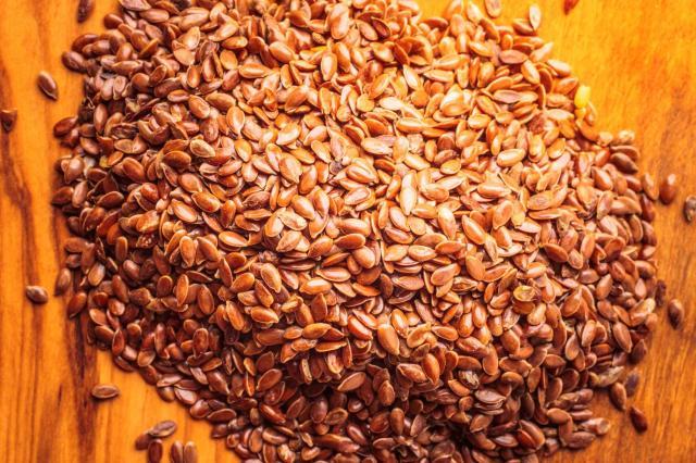 Heap of flax seeds linseed closeup