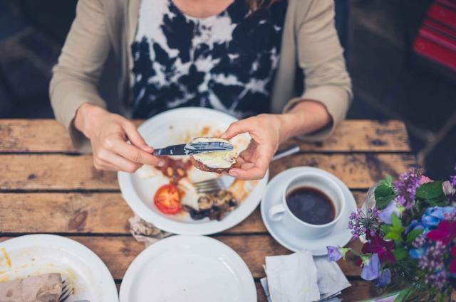 Young woman having an english breakfast