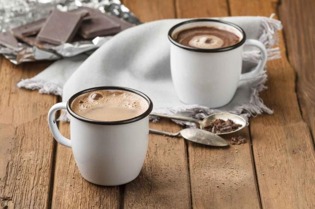 Hot chocolate with foam in two mugs