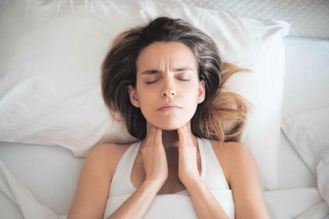woman in bed with chronic adult tonsillitis