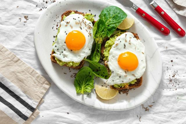 Top view healthy avocado toasts breakfast lunch avocado toast fried eggs white background