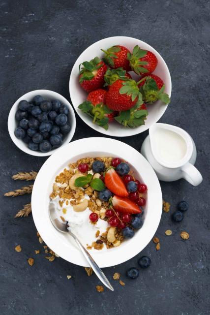 baked muesli with fresh berries and yogurt for breakfast