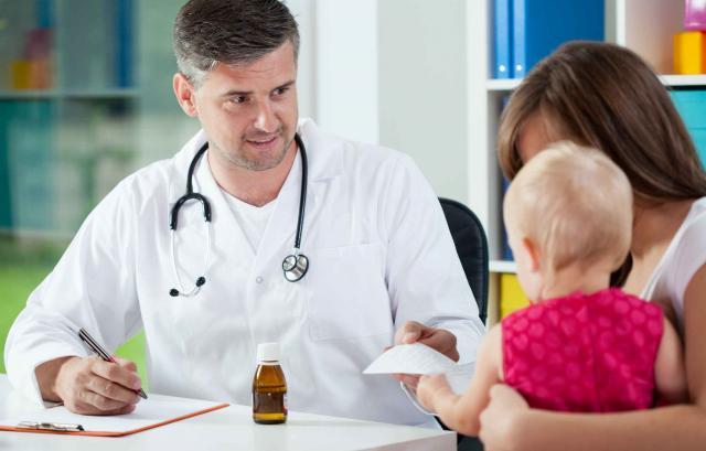 Pediatrician giving prescription