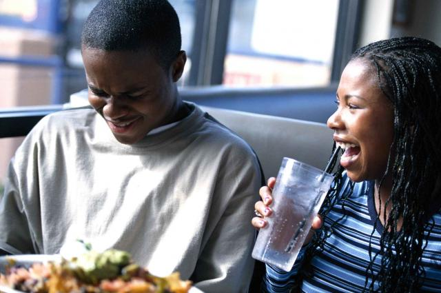Friends laughing at lunch