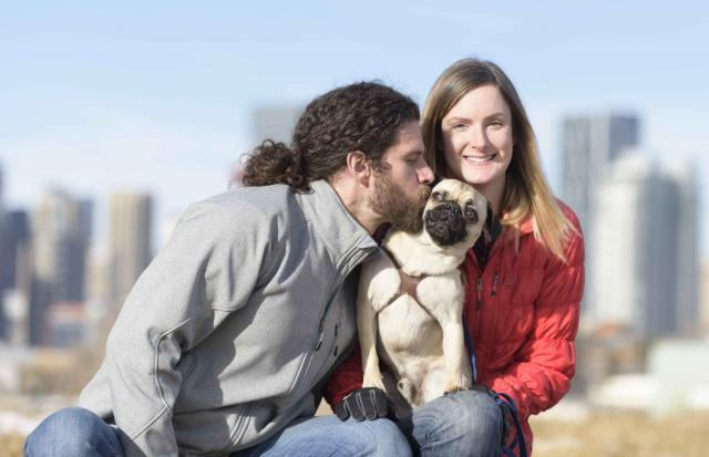 Attractive Interracial Couple Having Fun On a Cool Day with Healthy Pug