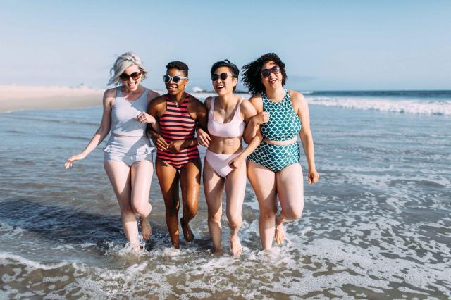 women having fun n the beach