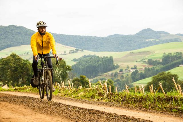 Front View of a Man With Bicycle on unpaved road