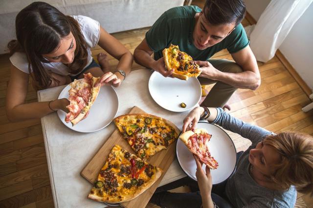 woman enjoying pizza