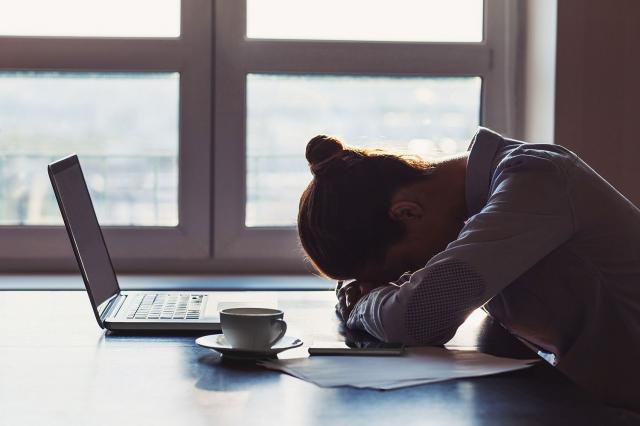 tired woman with laptop