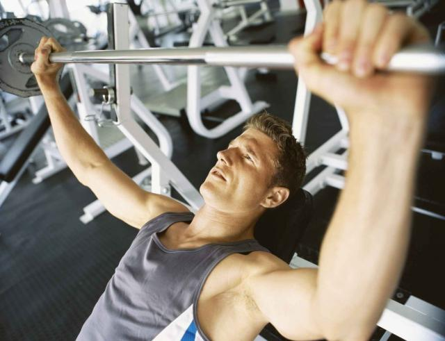 High angle view of a mid adult man lifting weights in a gym