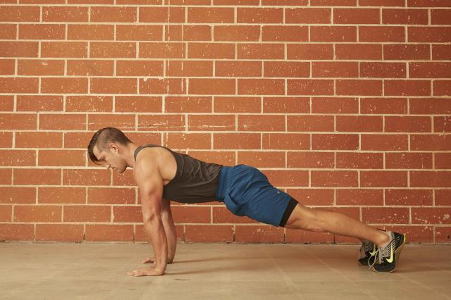 man demonstrating how to do a proper push-up