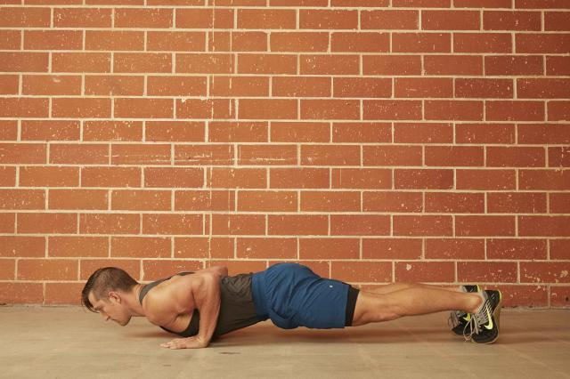 man demonstrating how to do a Standard Push-Up