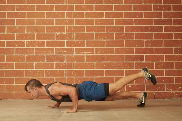 man demonstrating how to do a Staggered Hand & Single-Leg Push-Up