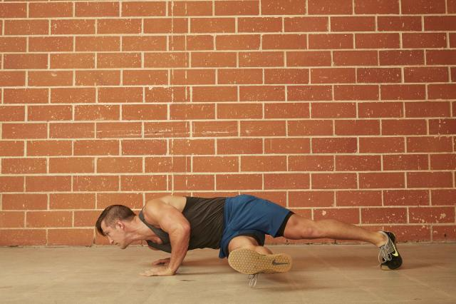 man demonstrating how to do a Hip Twist Push-Up