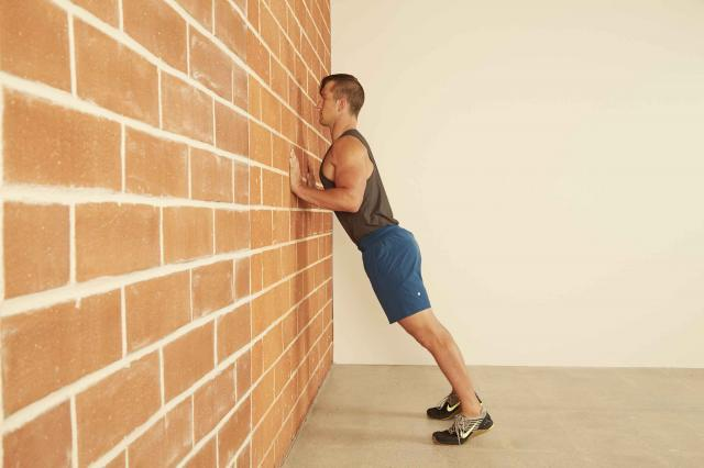 man demonstrating how to do a Wall Push-Up