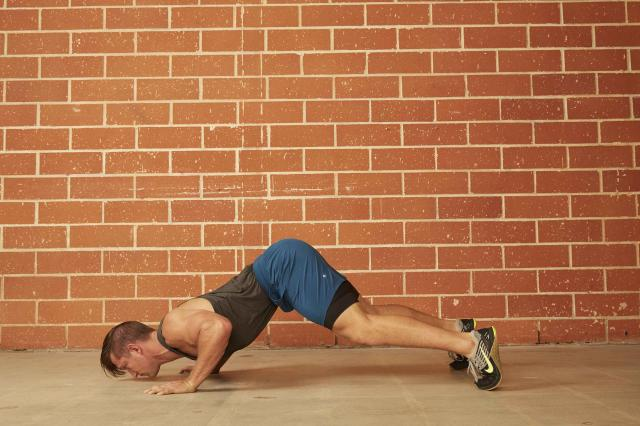 man demonstrating how to do a Divebomber Push-Up