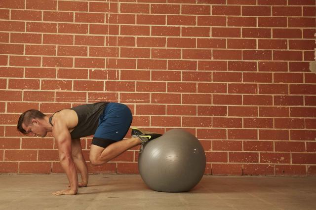 man demonstrating how to do a Stability Ball Push-Up With Pull-In