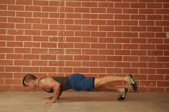 man demonstrating how to do a Single-Leg Push-Up