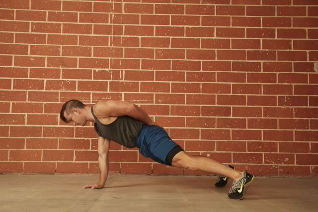 man demonstrating how to do a One-Arm Push-Up