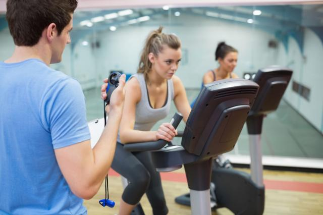 Instructor times women at Spinning Class