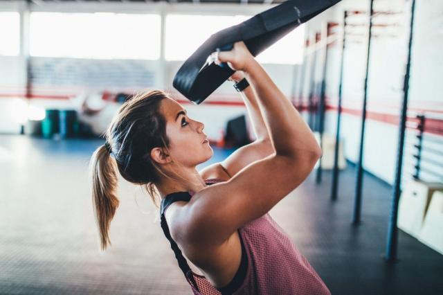 woman strength training at the gym