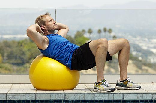 Man doing stability ball crunch exercise for better sex