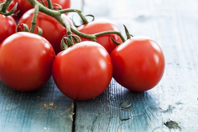 Fresh tomatoes on vintage table