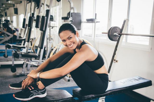 woman happily at the gym