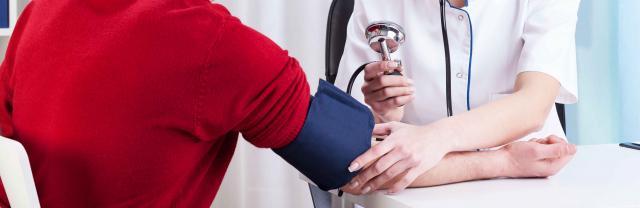 Female doctor measuring blood pressure