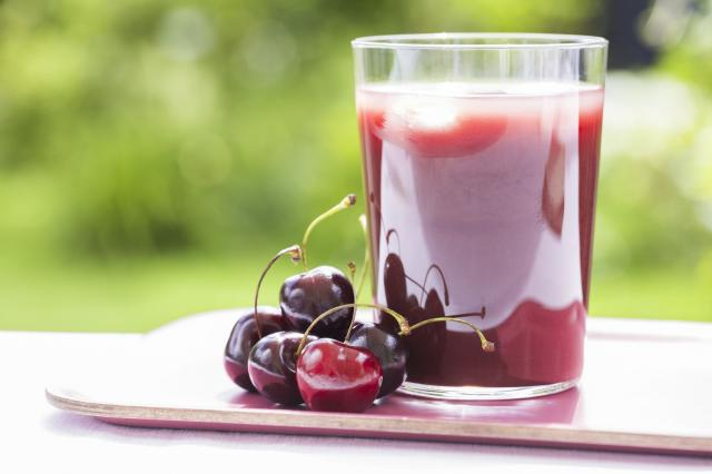 Glass of Cold cherry  juice in garden