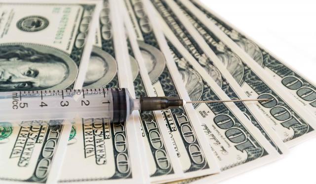 syringe on the money