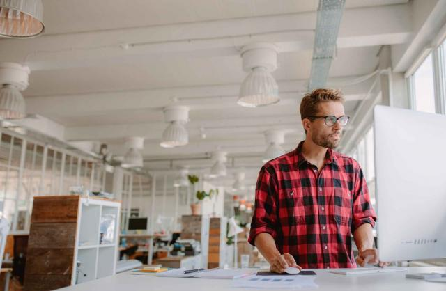 Young man working on computer in modern workplace