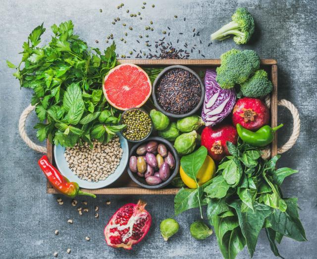 Vegetarian Healthy food ingredients in wooden box over grey background