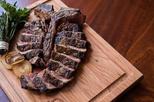 sliced steak on cutting board