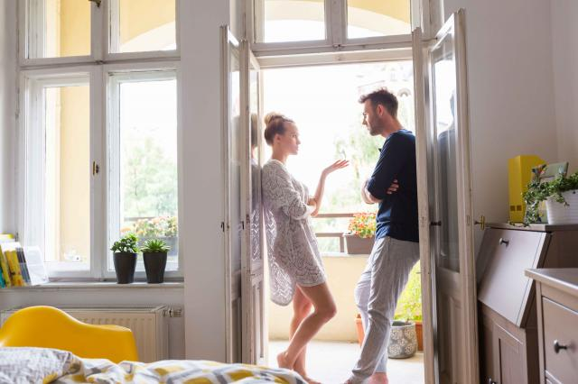 Couple arguing in the morning at home